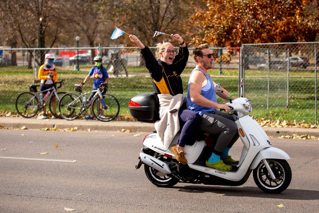 People driving around the Capitol honk and cheer in celebration of Joe Biden's victory in the U.S. presidential election. Nov. 7, 2020.