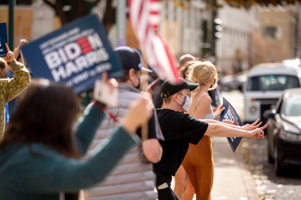 People gathered in front of the Colorado Capitol celebrate Joe Biden's victory in the U.S. presidential election. Nov. 7, 2020.