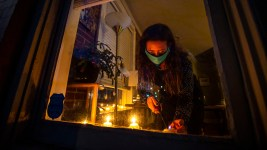 Denver Streets Partnership Executive Director Jill Locantore lights candles in the window of her City Park West home for a World Day of Remembrance for people killed in traffic crashes. Nov. 18, 2020.