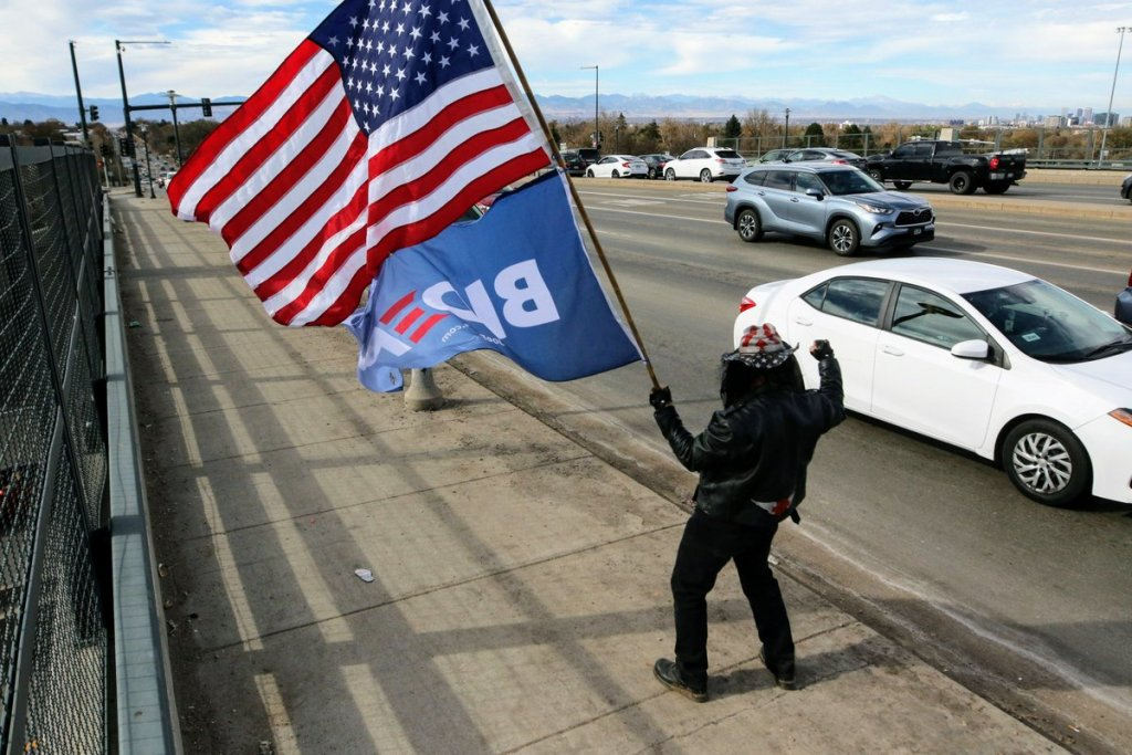 Walter Avko waves a Joe Biden flag on Election Day, November 3, 2020.