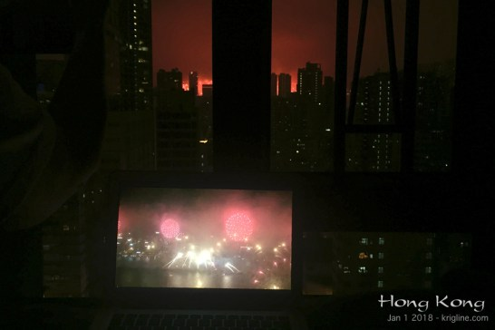 """Finally, it is hard to give you a good idea of what we can see from our window, but this shot comes close. The smaller screen is my computer, on which we are watching the Fireworks live via webcam! See the top of my """"links"""" page for this cool website."""
