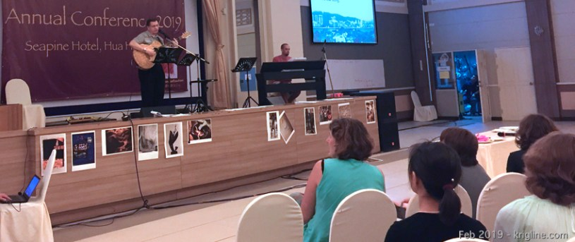 """Vivian is very active in conference planning, but we have a great team helping so we don't have to do too much during the event. Here, I'm singing one of the songs I wrote (see the """"Michael's Music"""" tab)."""
