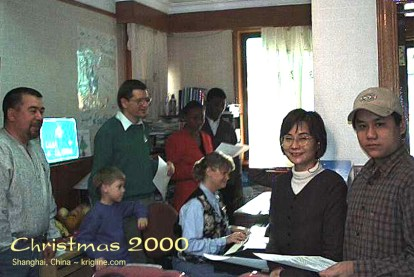 Vivian is playing piano in our Shanghai apartment, as we sing Christmas Carols with colleagues and friends.