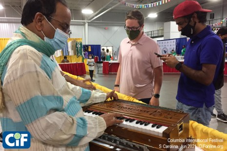 The 2021 Highlight Country was India; here an exhibitor demonstrates a traditional instrument. Around the clock, guests engaged their international neighbors, learning about different cultures and making new friends.