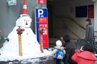 "Snowmen are a rare sight in ""Spring City""."