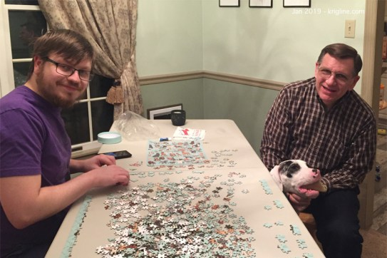 The Kriglines have enjoyed raising dogs and building puzzles for decades, so we presented this puzzle to the newlyweds for Christmas--it features dozens of dog breeds. Like most older siblings, Murphy seems jealous of the rambunctious new-comer, but we enjoyed playing with both!