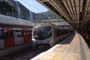 This train brought us home from the border today, just about two hours after we had left HK. But I took this shot a few days ago; notice how people wait in the shade to avoid September's hot sun.