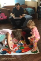 "The youngest doesn't quite understand ""Pizza Twister"", but wants to be like the big kids!"