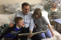 Back in S Carolina, Grandpa and the kids enjoy a library book together.