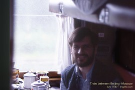 """This dark fuzzy photo inside the train (showing my fuzzy beard) is the only color image I can find of myself from that trip. I guess """"selfies"""" were not common back then."""