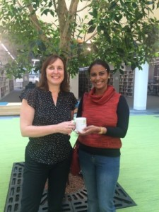 Lakshmi receiving an ORCiD mug with her personalised ID