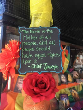 "a sign reading ""the Earth is the Mother of all people and all people should have equal rights upon it"" by Chief Joseph"