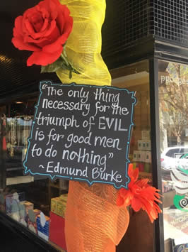 "a sign reading ""the only thing necessary for the triumph of evil is for good men to do nothing"" by edmund burke"