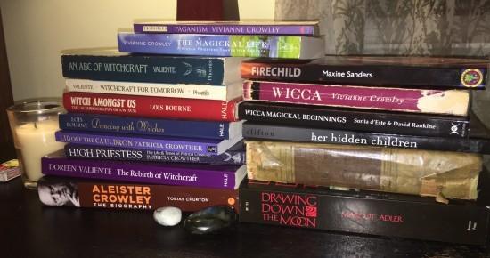 Teetering pile of books on my nightstand ~ Photo by Heron