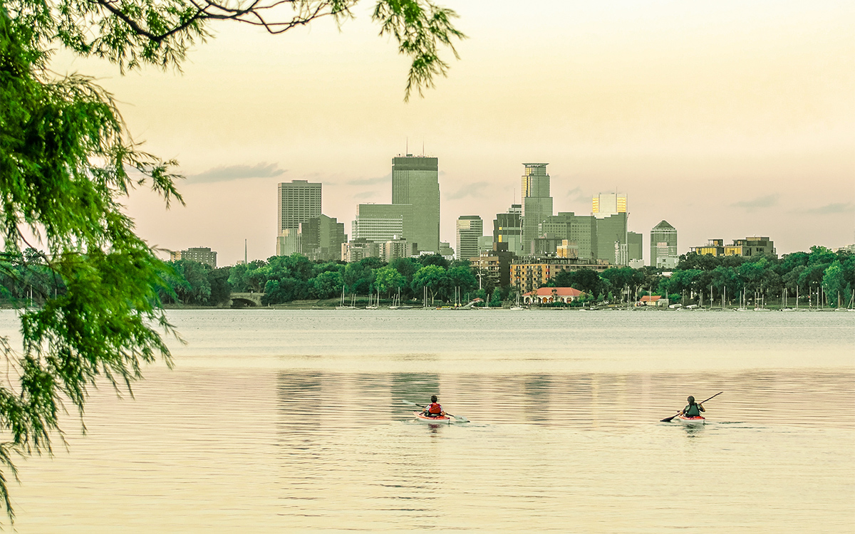 Minneapolis lake with a skyline of the city in the background