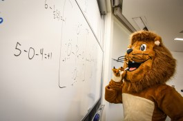 Ole the lion learning in class