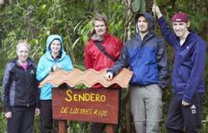 St. Olaf students (from left) Ellen Hawley '13, Justine Dammermann '14, Reed Deardorff '13, Andy Catania '13, and Daniel Malecha '13 stand next to the sign they constructed at the start of the trail they constructed in rural Costa Rica.