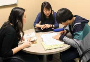 St. Olaf students taking Korean through the ALSO program gather for a weekly tutoring session led by a native speaker. Photo by Duy Ha '14