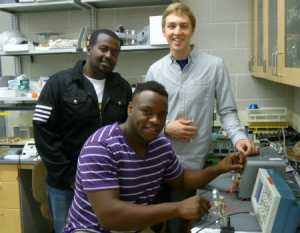 Erick Marigi '14, Guttu Maskalo '14, and Shane Allen '14 at work in their lab.