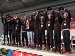 Members of the St. Olaf men's cross country team celebrate after winning the national championship Saturday.