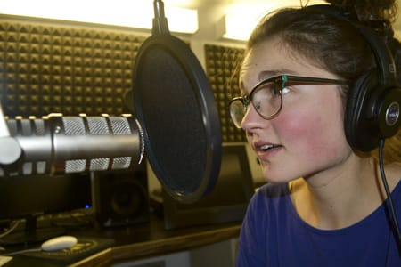 """Liz Brindley '15 records the audio for her Collection Stories segment. """"The intention of this project is to start the conversation around artwork,"""" she says."""