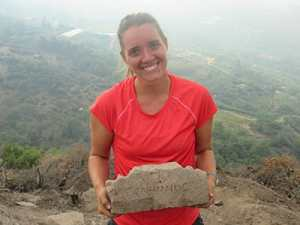 Elizabeth Bews '15 holds an inscription she discovered in the church at Antiochia ad Cragum last summer.