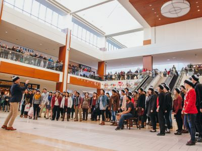 Mark Stover conducts St. Olaf students in a pop-up performance.