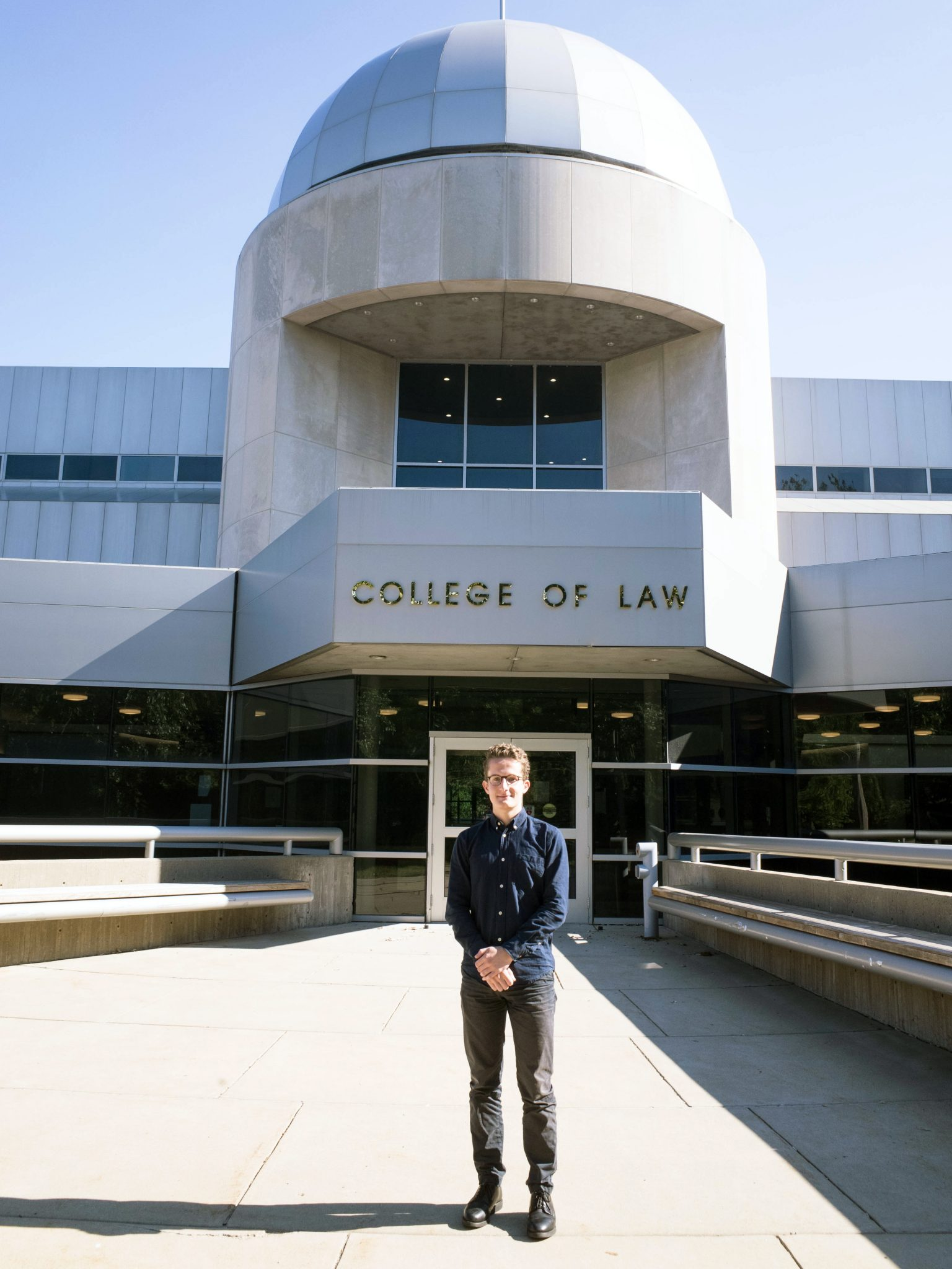 Sumner Pitt '19 stands in front of the University of Iowa College of Law.