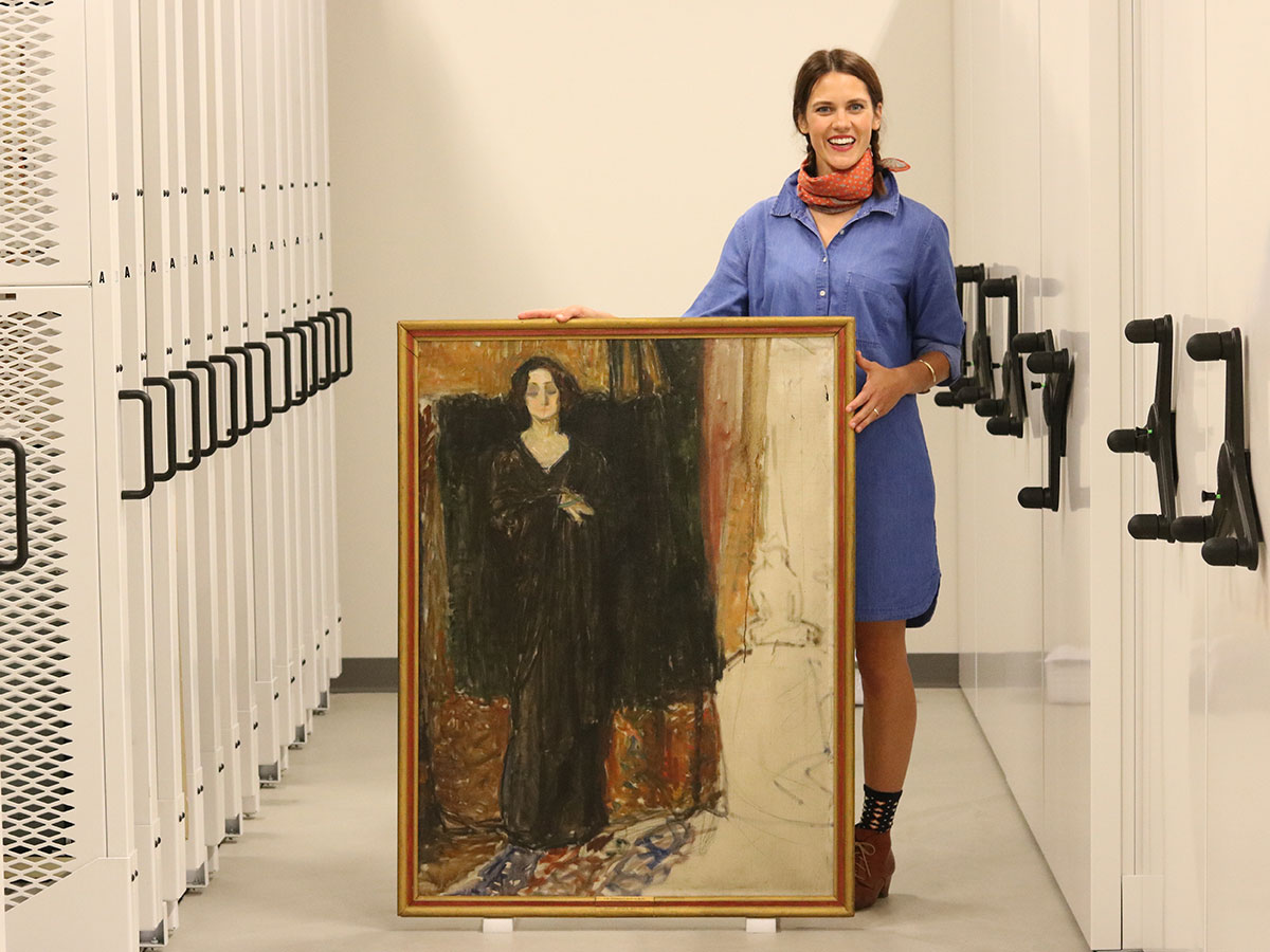 """Jane Becker Nelson holding """"Eva,"""" an unfinished painting that will undergo scientific testing."""