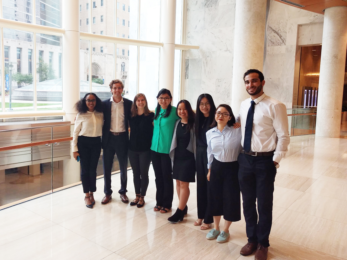 Eight St. Olaf students who participated in this summer's Mayo Innovation Scholars Program pose for a portrait at the world-renowned medical facility in Rochester, Minnesota.
