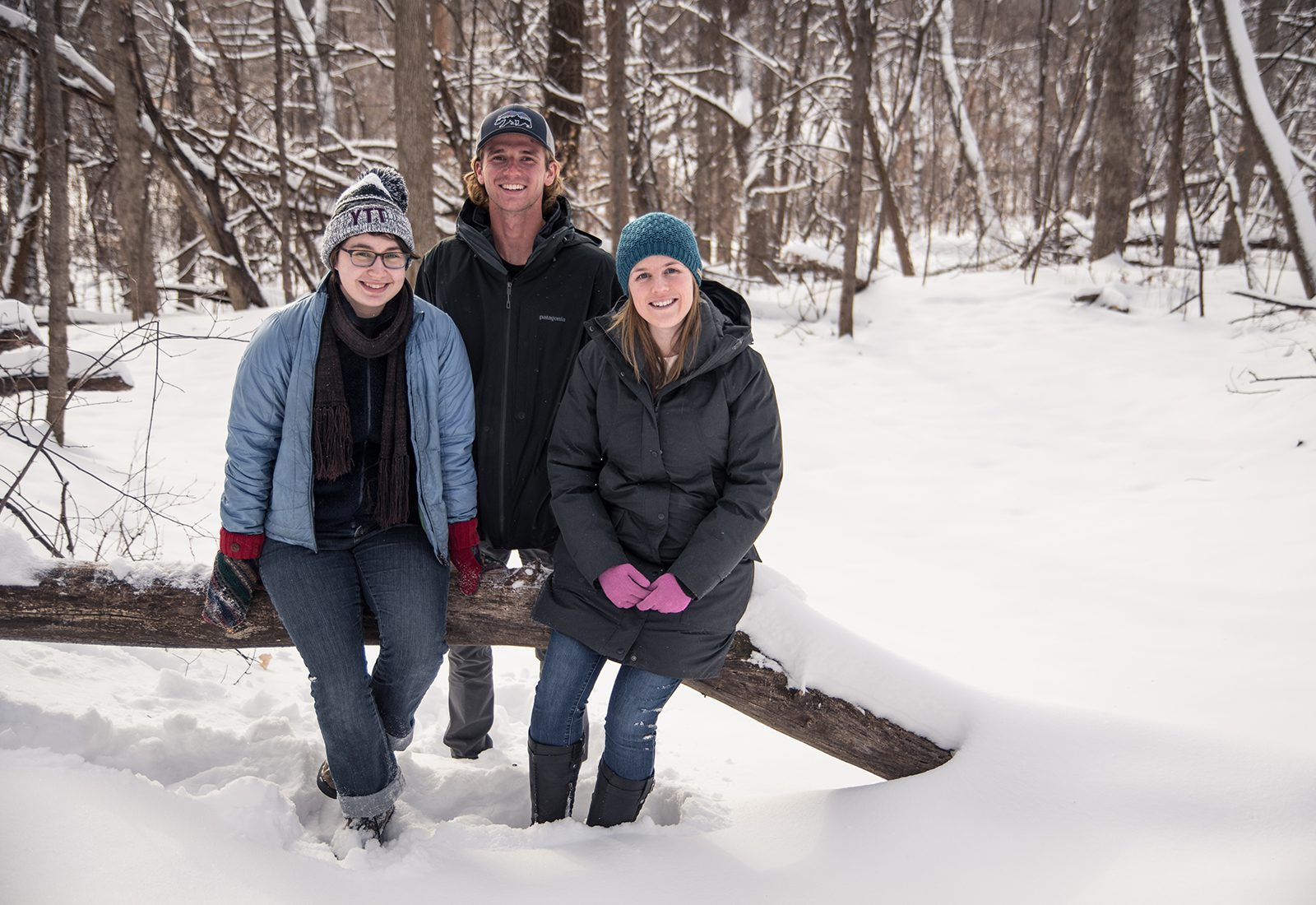 Student researchers Karina Zikan '20 and Wesley Brown '19 with Assistant Professor of Physics Alden Adolph in St. Olaf's Natural Lands.