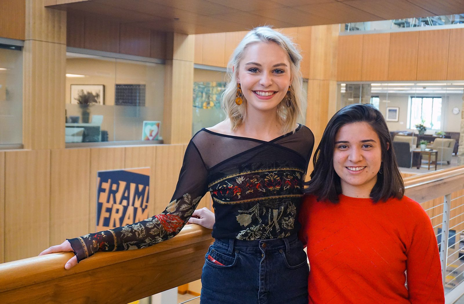 Kristina Quanbeck '21 and Manuela Novoa Villada '21, this year's Smaby Peace Scholars, stand in front of the balcony in the Tomson Hall Atrium.