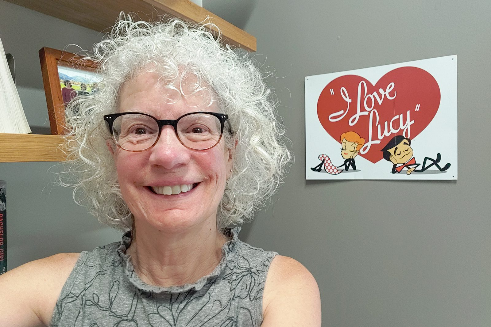 """Professor of History Judy Kutulas with the """"I Love Lucy"""" sign in her office."""