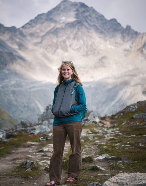 Portrait of student naturalist Ella Doud in front of mountains.