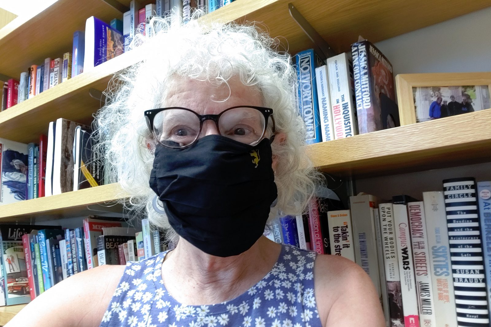 Professor of History Judy Kutulas prepares to teach in her face mask.