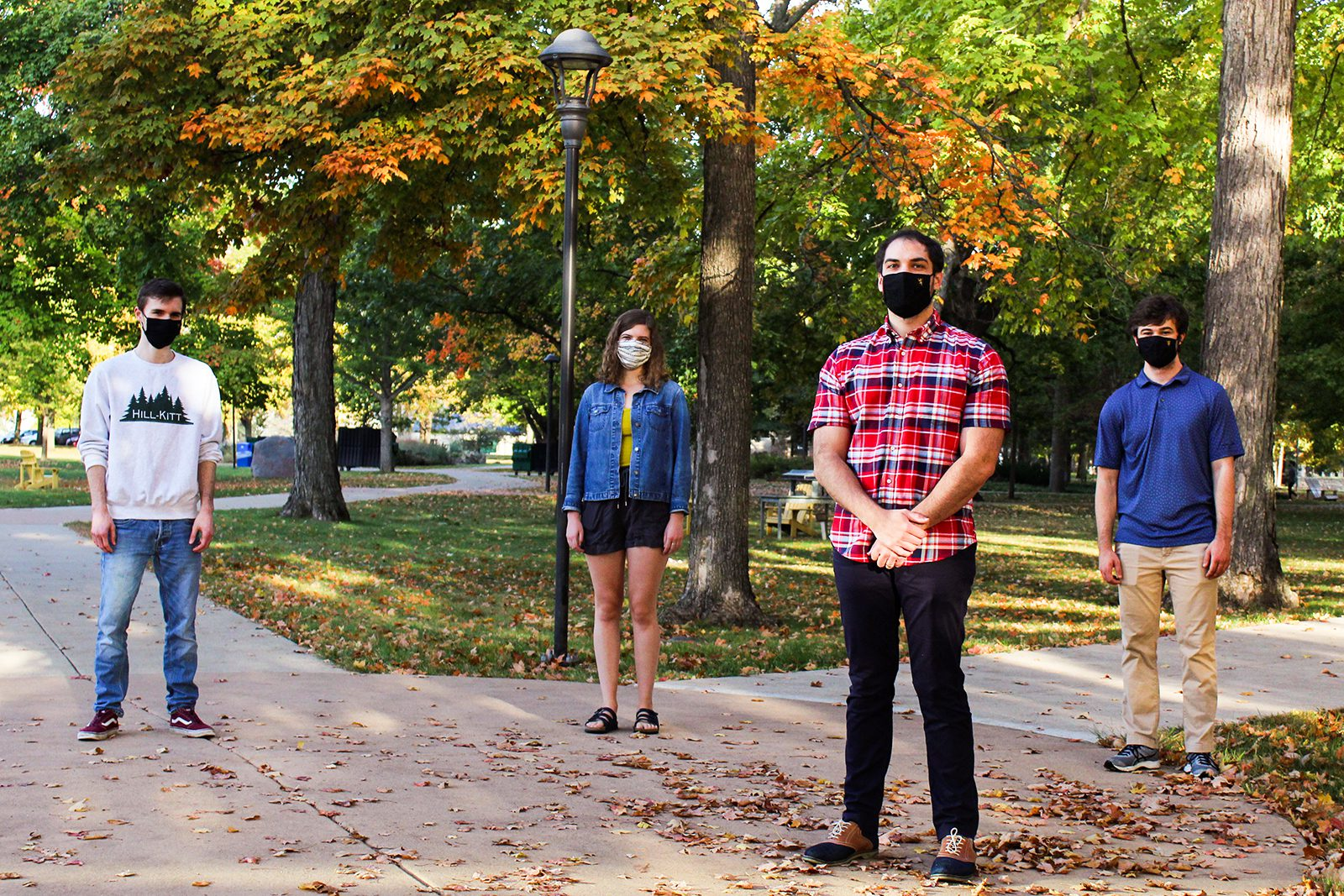 Assistant Professor of Mathematics, Statistics, and Computer Science David Walmsley (front) on campus this fall with Math 119 Academic Assistants (from left) Ethan Ormerod '22, Martha Barnard '21, and Noah Hillman '21.