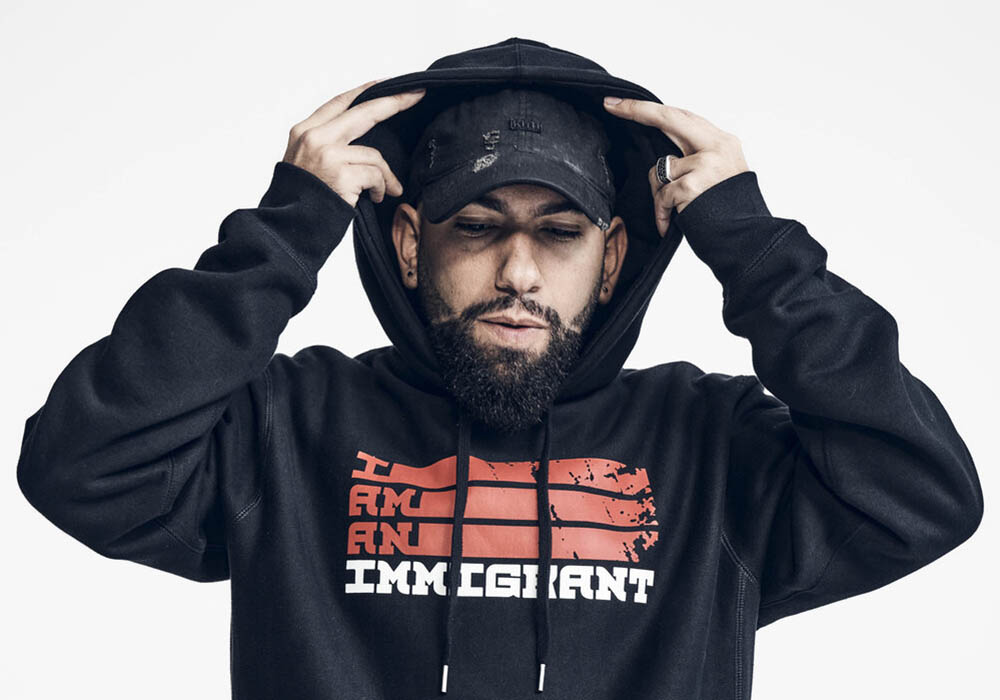 "A portrait of Daniel Alejandro Leon-Davis wearing an ""I am an immigrant"" hoodie."