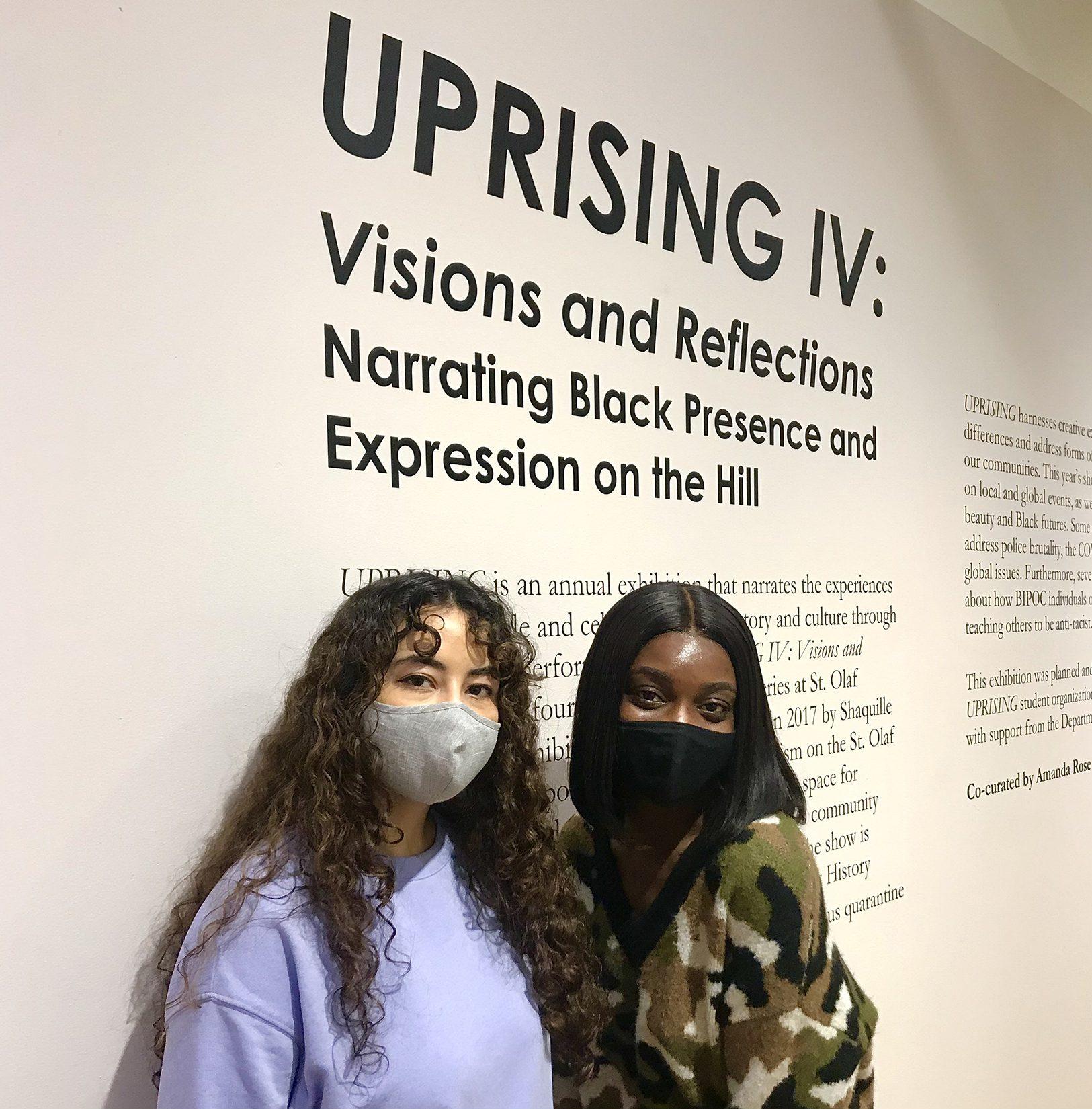 UPRISING IV co-curators Amanda Rose '21 (left) and Bridget Asamoah-Baffour '21 in Flaten Art Museum.