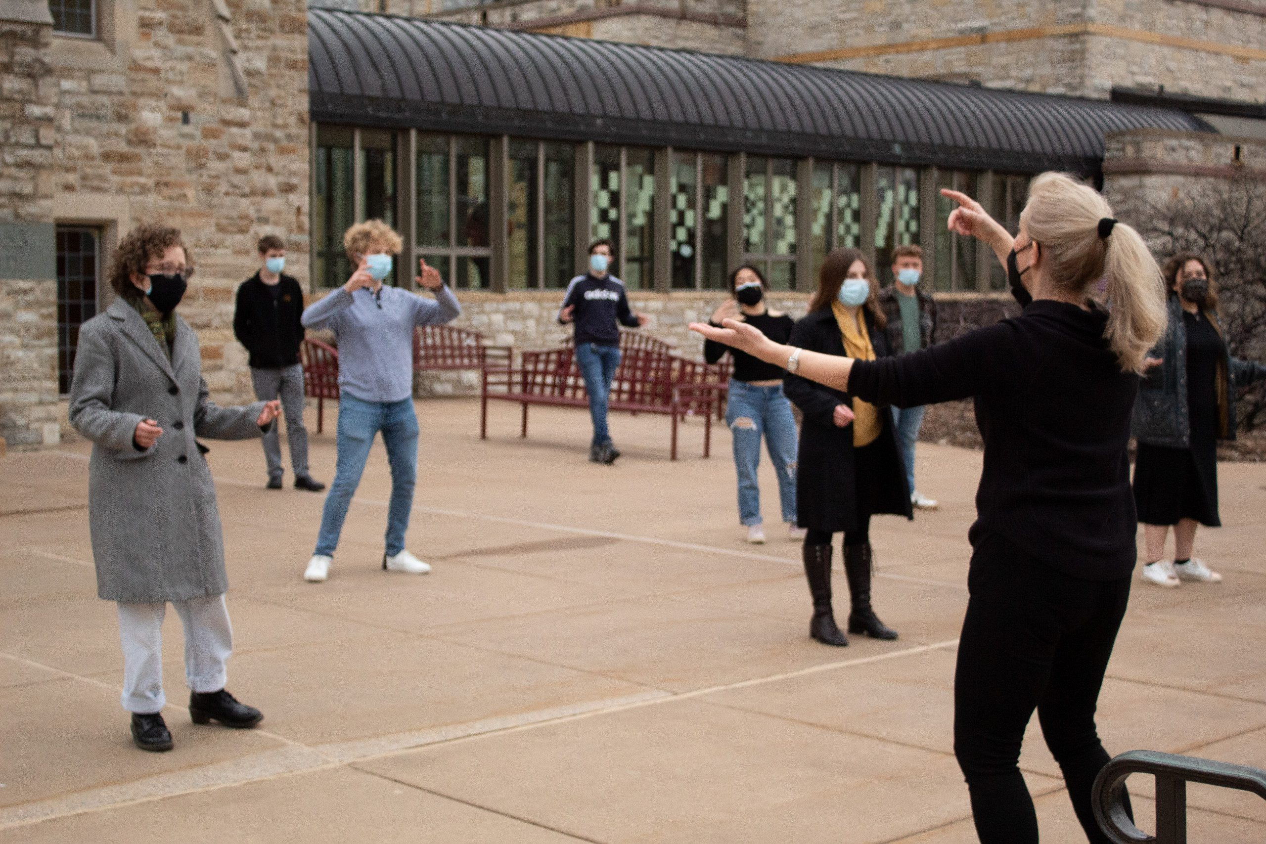Music faculty member Therees Hibbard leads the St. Olaf Chamber Singers in rehearsal outside of Boe Memorial Chapel.