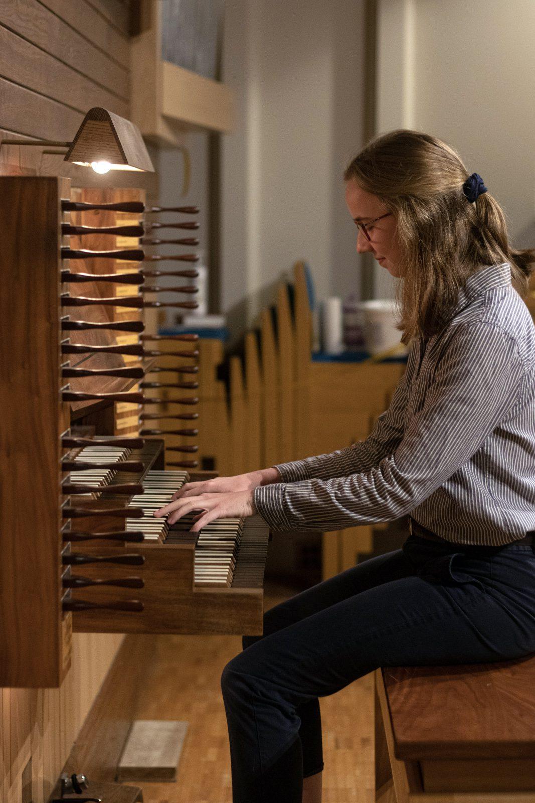 Katie Gunn plays organ.