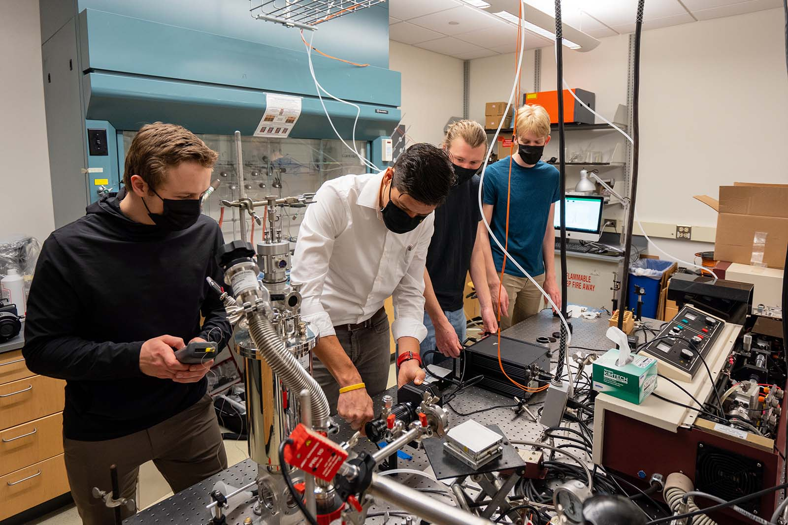 Assistant Professor of Chemistry Rodrigo Sanchez-Gonzalez (second from left) and the researchers in his Laboratory of Energy and Advanced Diagnostics (LEAD) at St. Olaf work with a new collection of scientific equipment from the NASA Langley Research Center.