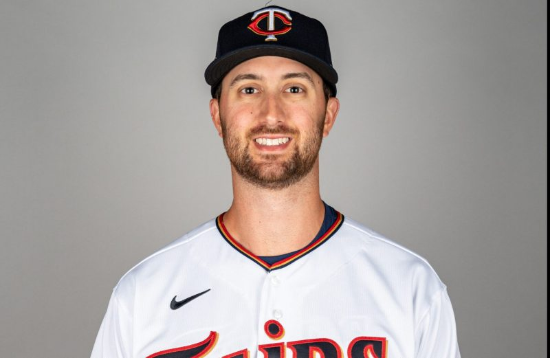 Anders Dzurak '13 poses for a headshot in his Minnesota Twins attire.