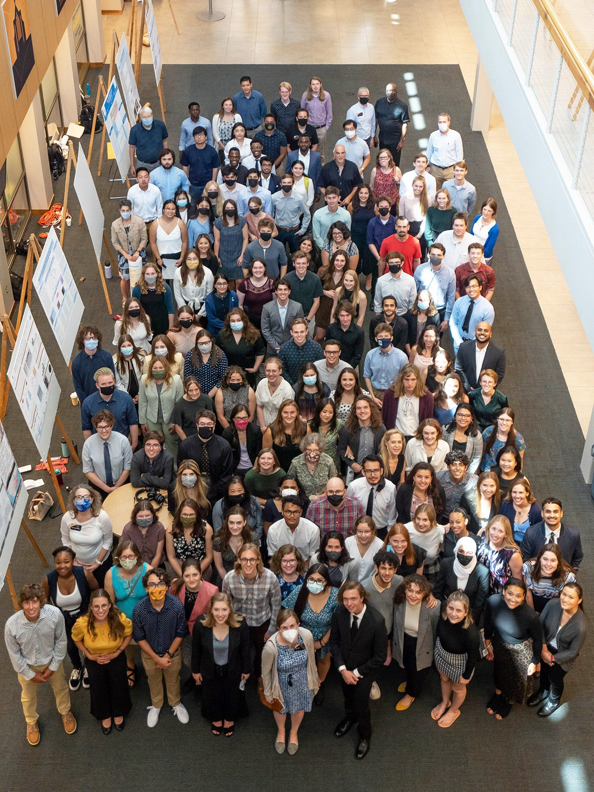 CURI student researchers and faculty members gather at the August 6 closing symposium in Tomson Hall.