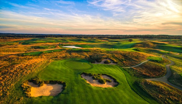 Still photos from the first drone session at Erin Hills, a daily fee destination golf course and resort in Erin, Wisconsin and site of the 2017 US Open Championship. The course was designed by Hurdzan/Fry and Ron Whitten and built by Landscapes Unlimited, LLC. It opened for play in 2006 and has already hosted the 2011 US Amateur Chanpionship and the 2008 Women's Amateur Public Links. Photograph and copyright by Paul Hundley, September, 2015. Drone piloted by Travis Waibel.