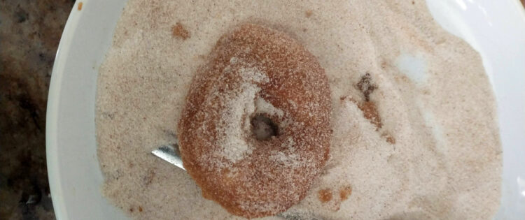 gluten free doughnut coated in cinnamon sugar mixture