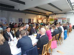 Fotos zeigen Einblicke in die Veranstaltung im zukünftigen Küchenstudio.