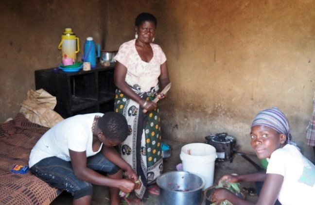 Preparing food in Mitume Slum