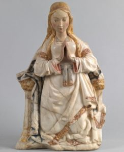 medieval sculpture of virgin is from 20th century