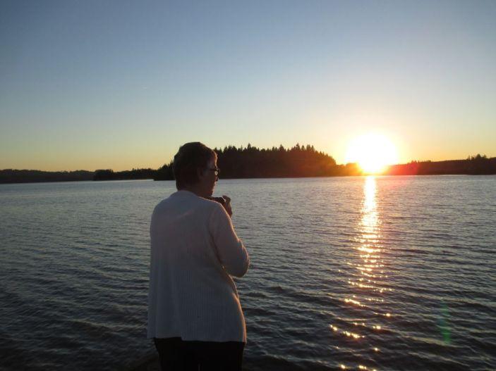 Martha Wasik enjoys the sunset at Silver Lake WA.