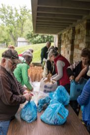 WPMC cultivation night - volunteers bag up some of the cotton seed hulls.